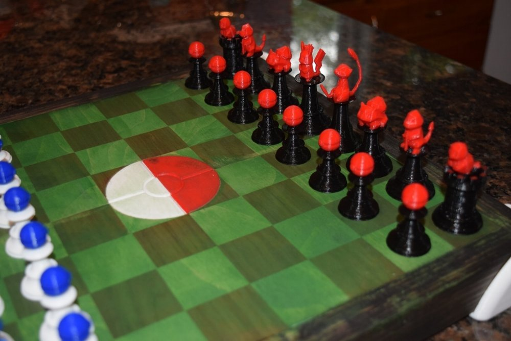 A more focused view of the red/black Mew team on the multi color Pokemon Stadium chess set. The center board Pokeball was 3D Printed and inserted into the board. These parts were made using Hatchbox3D PLA and 3D printed with the Prusa i3 MK2