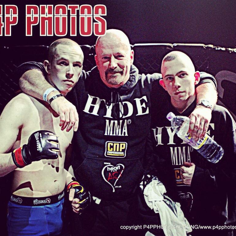Left to right: My brother George, my dad and myself following George's successful professional MMA debut in 2014.