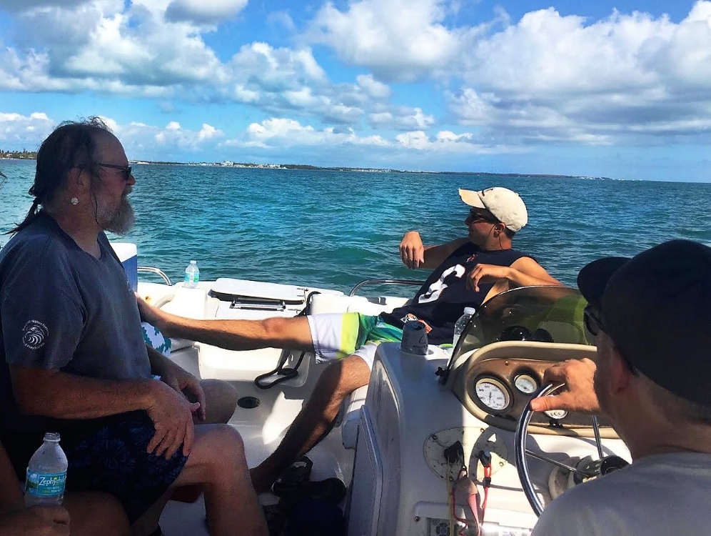 George L. Heinrich, Harrison Barzyk, and Bob Krause (left to right) returning from a successful search for a hawksbill sea turtle in the Florida Keys. Photograph by Jim Barzyk.