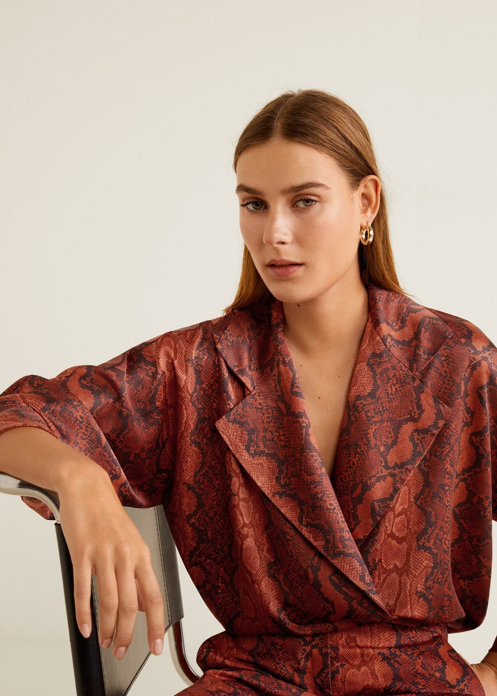 Mango Snake Print Shirt - £49.99 at MangoThe oversized lapels on this shirt bring a menswear edge to this statement top. It's definitely pricey, but you'll get a lot of use out of it.