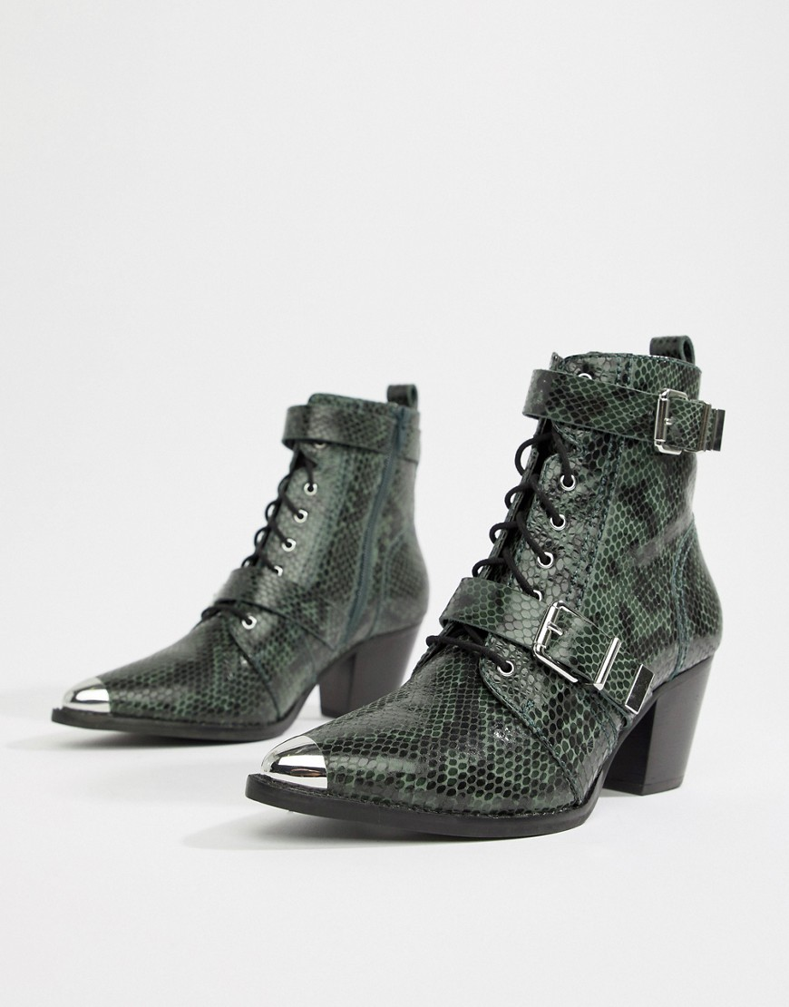 ASOS Design Rhythmic Premium Leather Lace Up Boots in Snake - £80 at ASOSIt doesn't get more bad ass than this. With a steel capped toe, double buckle detail and a tip so pointed you could kill a man, these would look awesome under a midi-length dress.