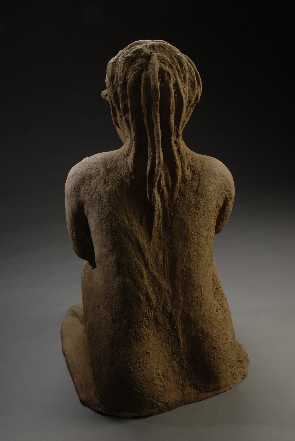 working woman_back view_clay_adobe 300.jpg
