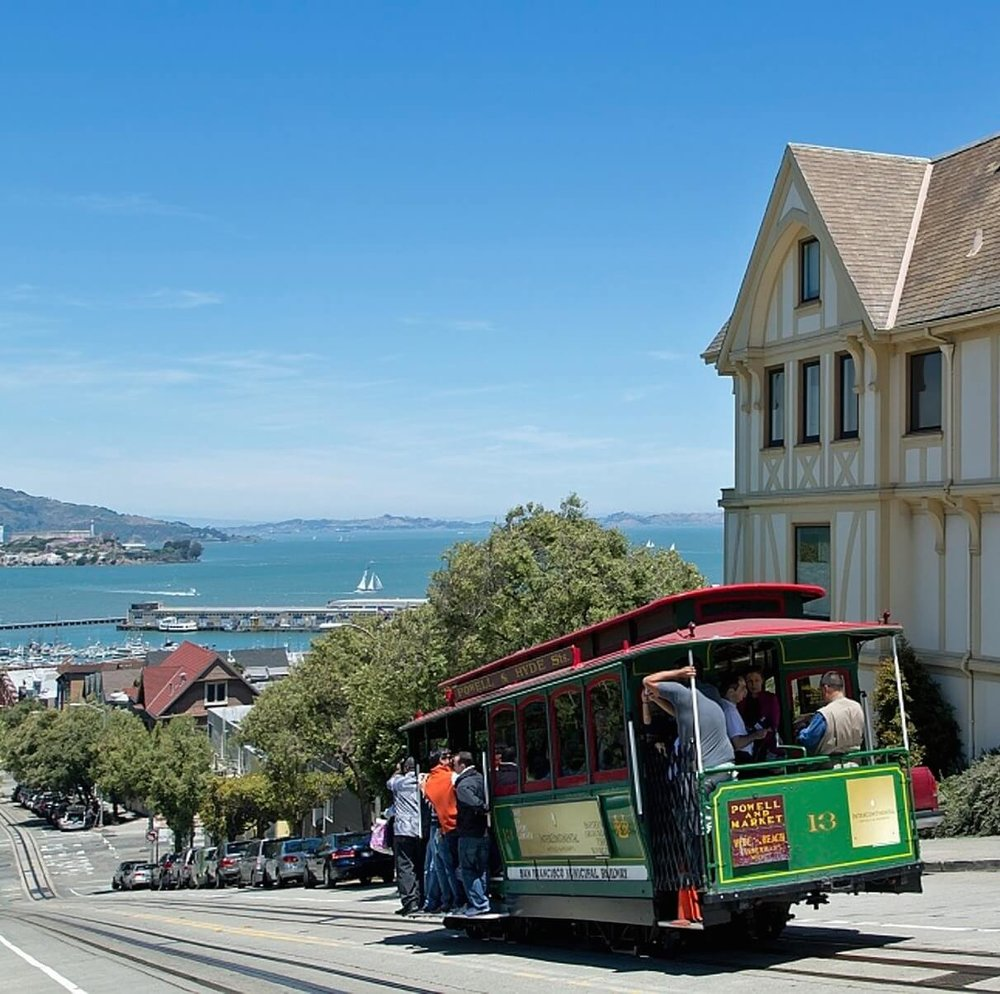 Cable car in San Francisco with view of Alcatraz