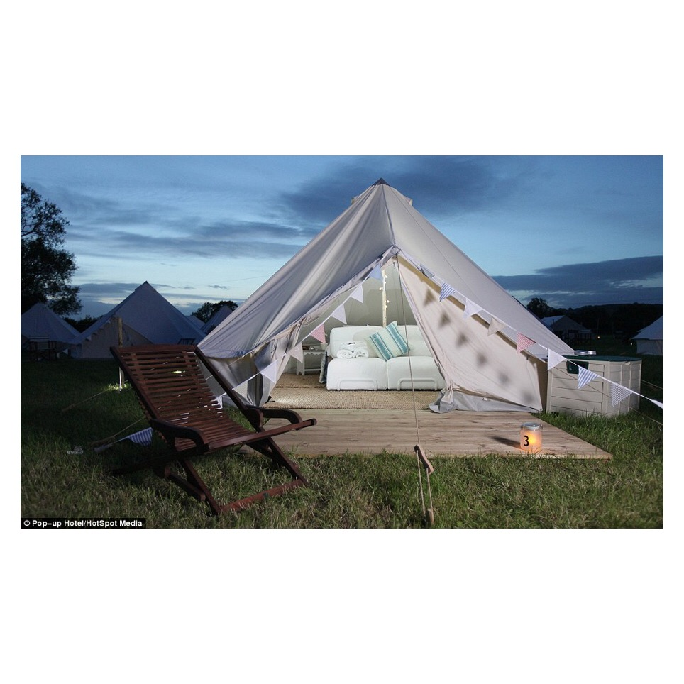 Superior tent - Probably the very best a bell tent can be with full sofa and furnishings for two to four guests.