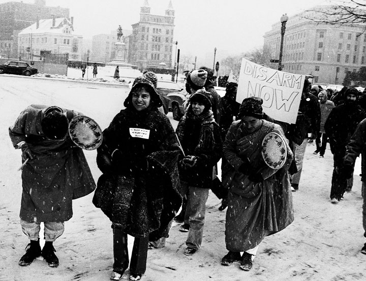 """Norma Becker, WRL Chair, in front with Buddhist monks. Norma was one of seven who held a """"No Nuclear Weapons! No Nuclear Power! USA or USSR"""" banner in Red Square."""