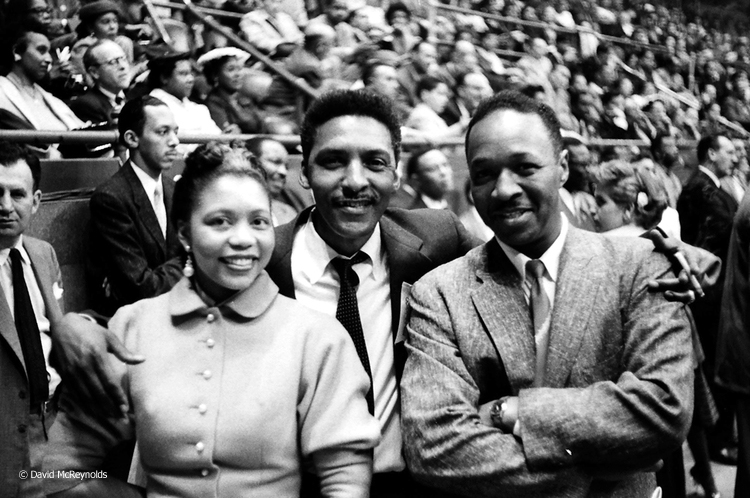 Bayard Rustin, center, with musician Josh White, right. The woman is not identified as yet.