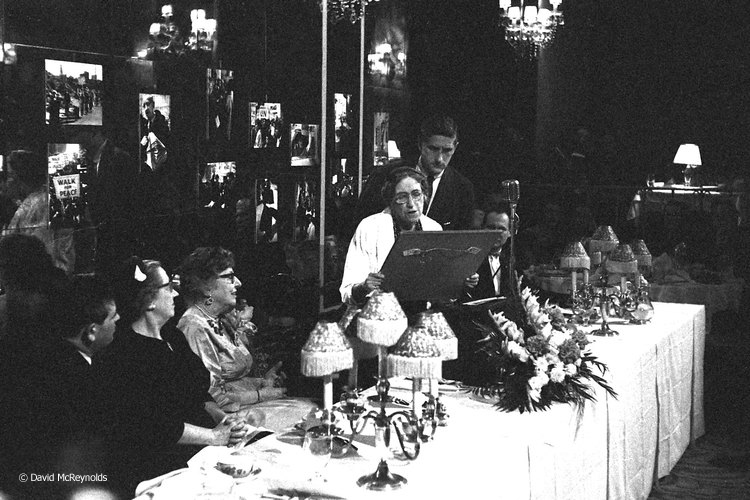 Tracy Mygatt, with WRL Chair Roy Finch behind her, presenting the award plaque to honoree Jeannette Rankin, NYC 1958.