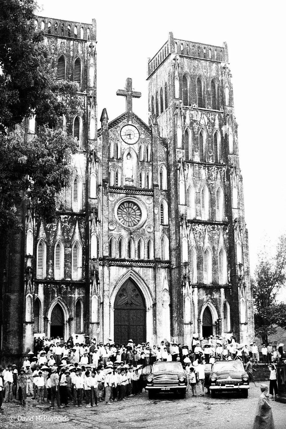 Catholic Church and congregation after mass. Hanoi, 1971.