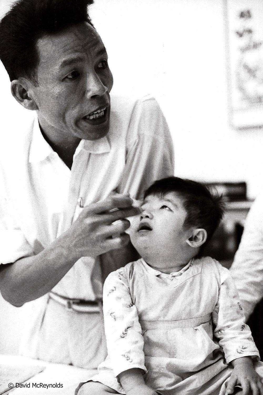 Child deformed by agent orange. Hanoi, 1971.
