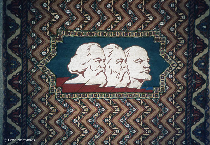 A common tapestry theme with Marx, Engels, and Lenin.