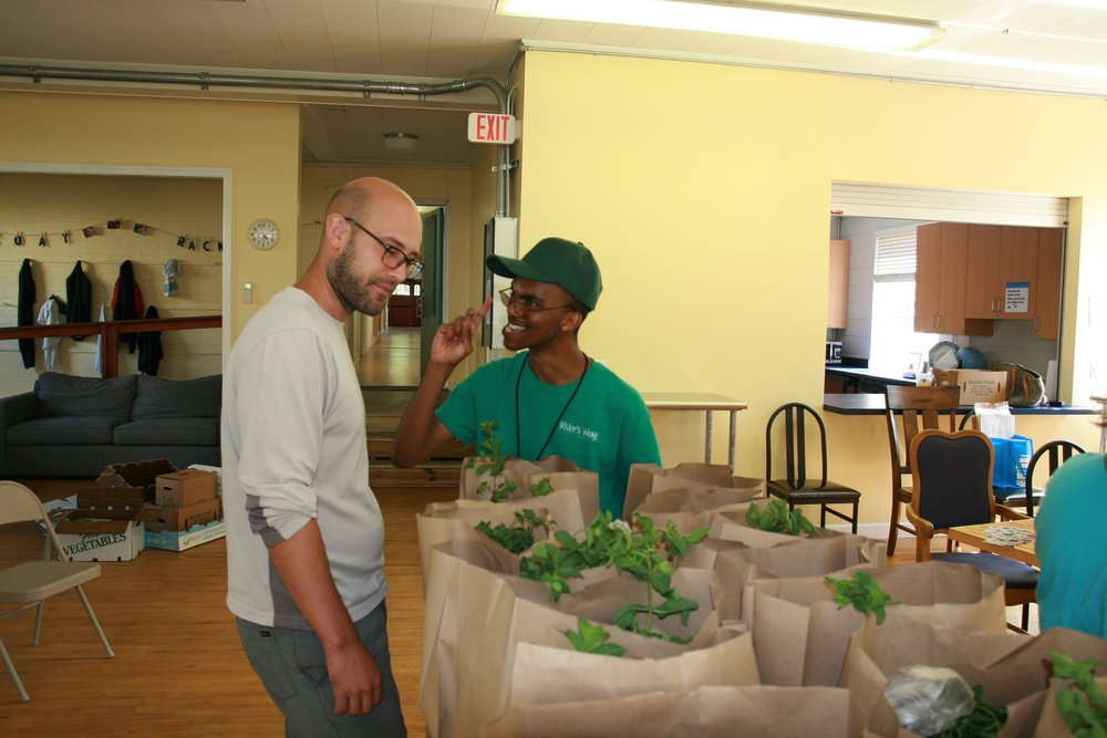 Decarlos tells Greg about all of the fresh veggies in his share this week.