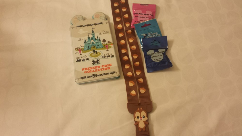 Loot from the day- including a new Animal Kingdom lanyard and my pressed penny folder!