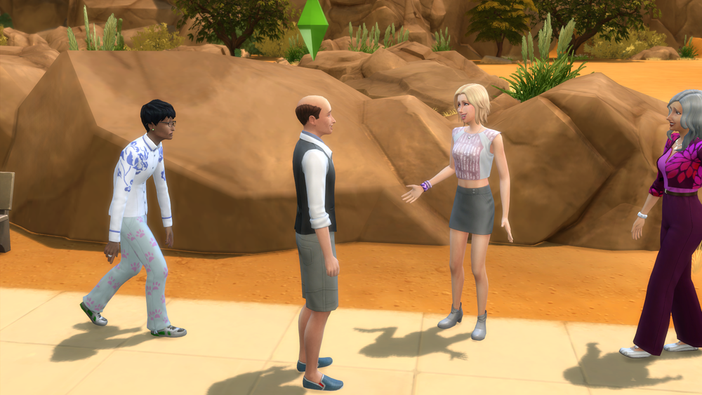 Chatting with Sofia. Check out the outfit of the person behind Salv, though. Those pants! :heart_eyes: