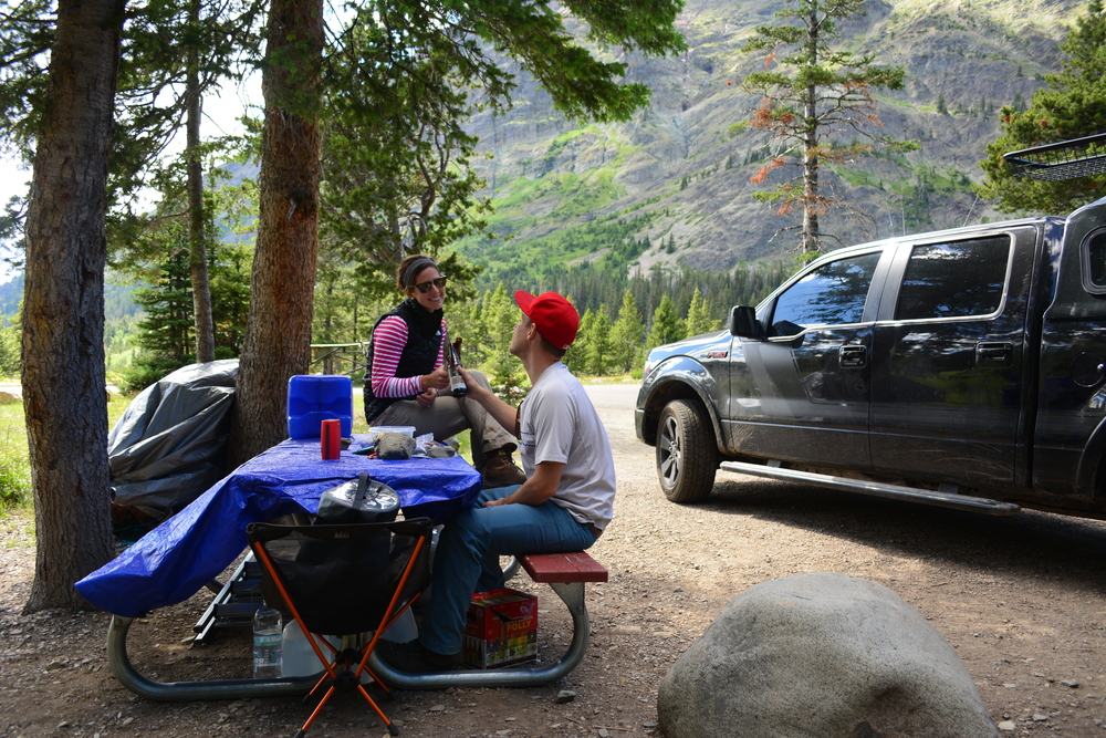 Enjoying a post-hike snack at our camp spot in Two Medicine.