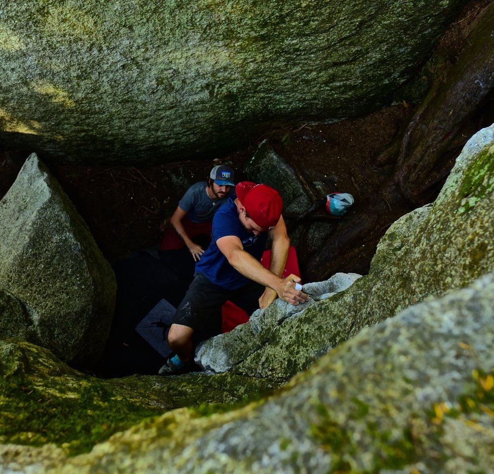 Attempting a tough bouldering problem