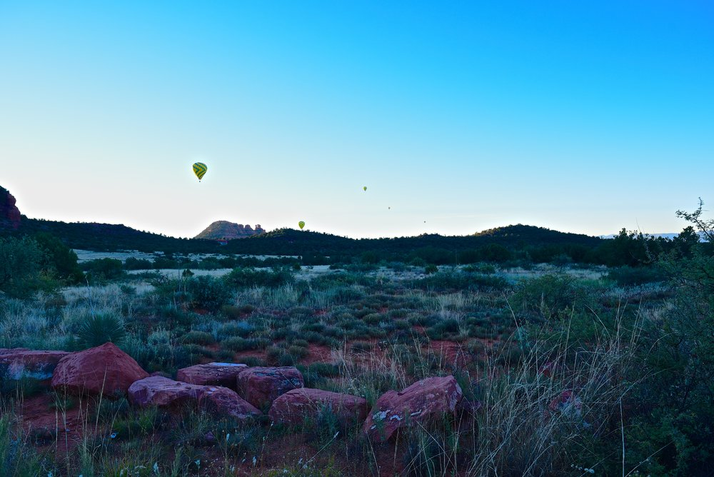 Daily hot air balloons rising up into the sky from our campsite