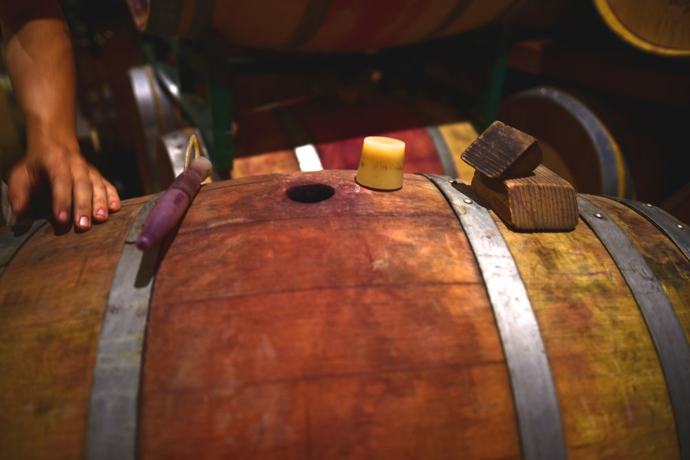 Prepping to extract wine from the barrel