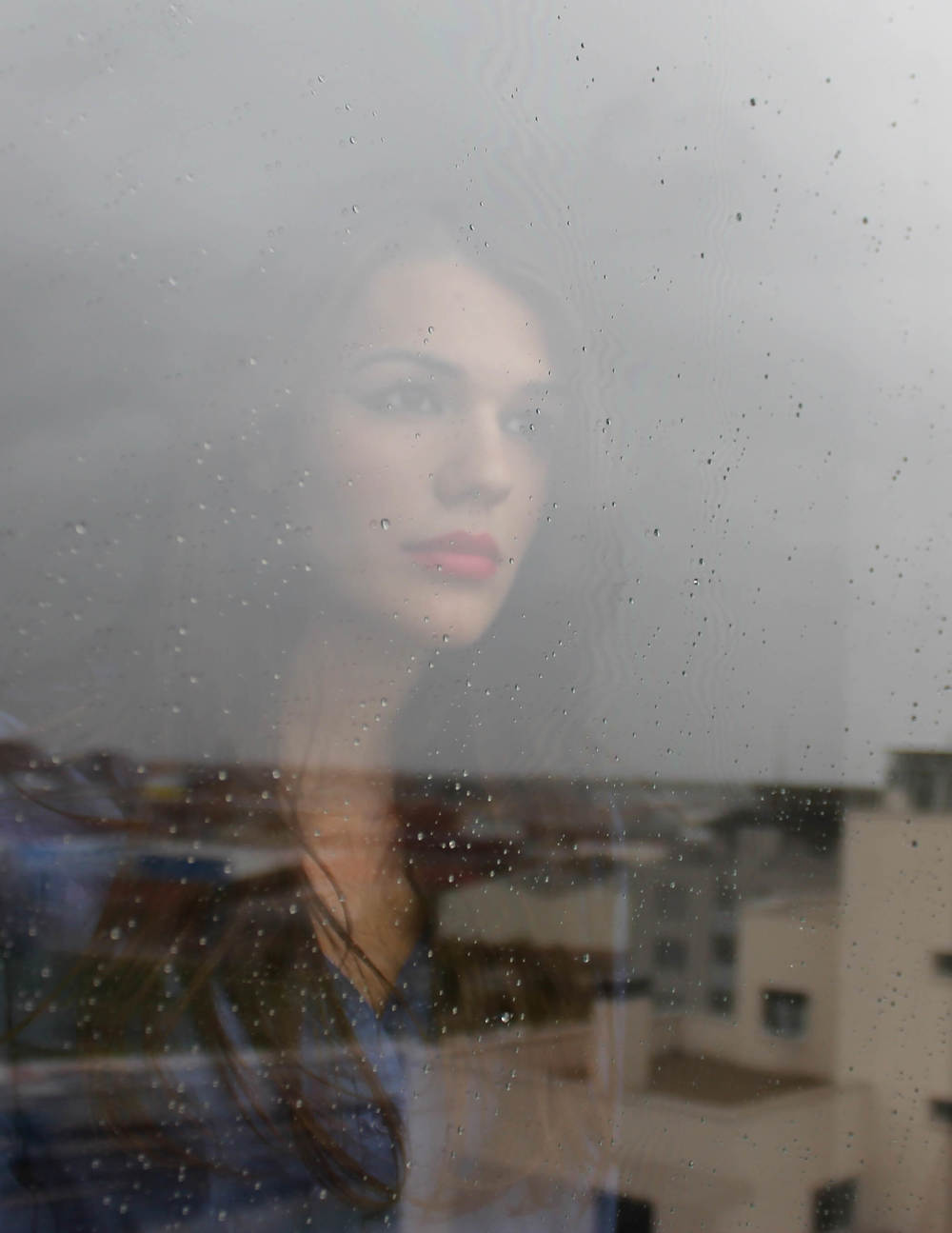 Woman Window Rain