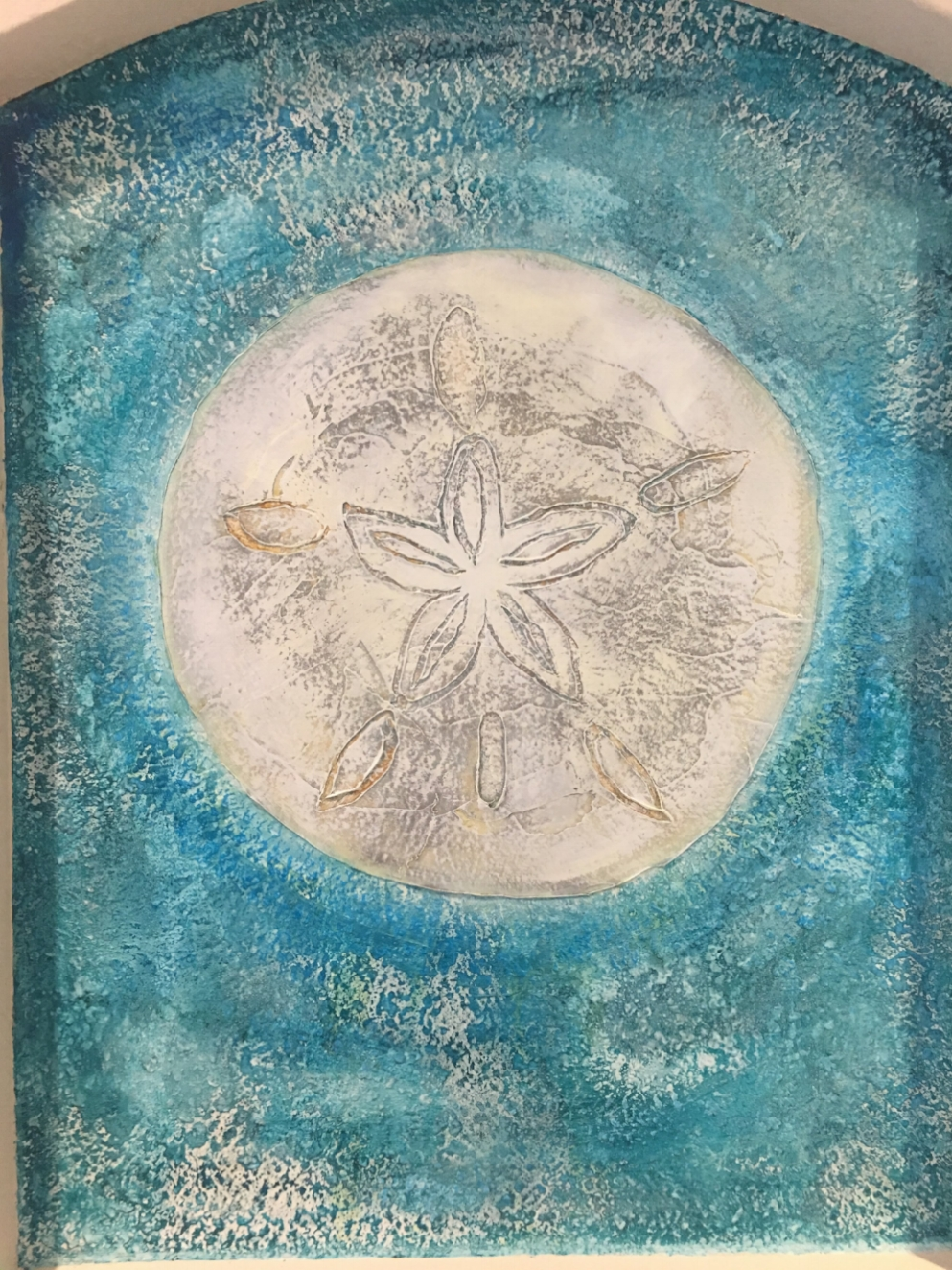 Hand painted with amazing variated texture, this sand dollar was applied on a wall inside an art niche, but would look amazing as a focal point for any wall, indoors or out.