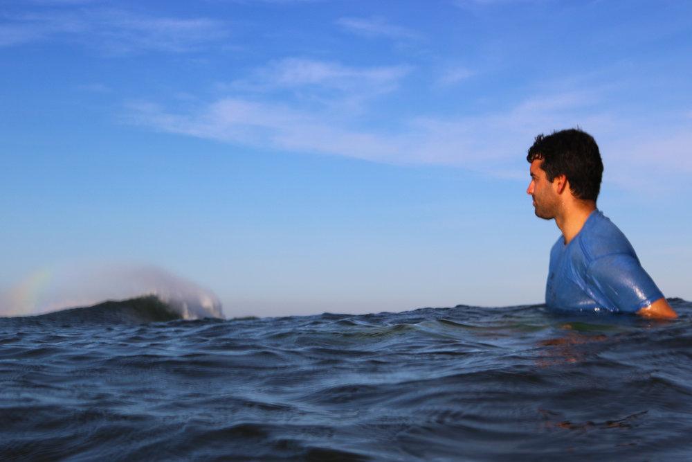 A rainbow off the backwash as Eric waits for the next line.Follow  Santa Cruz Surf Lessons on Instagram