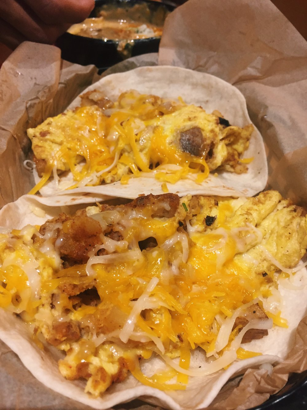 potato, egg and cheese breakfast tacos from Torchy's Tacos