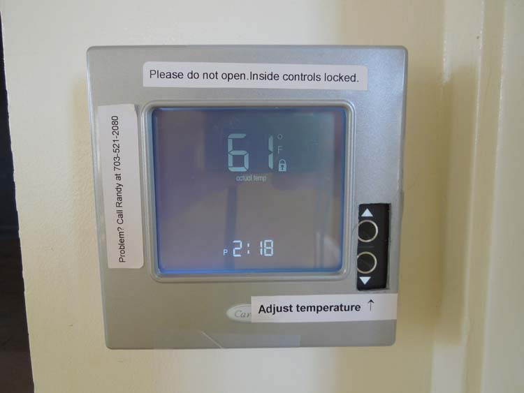 The thermostat is to the right of the stage