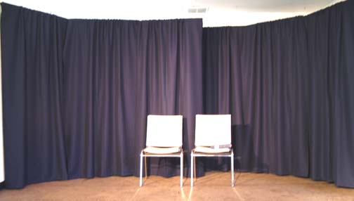 The stage set up with the drapes in place.