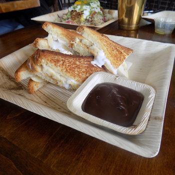 Fluffernutter sandwich with dark chocolate dipping sauce.