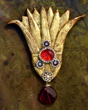 LOTUS, important brooch in resin, hand-painted and gold-leafed, with Gripoix glass cabochon, pearl, Swarovski rhinestones, chainette and hand-made dark red glass Gripoix bead. One of a kind. Hand signed, Billy Boy 1985. Dim resin piece: 4 inches