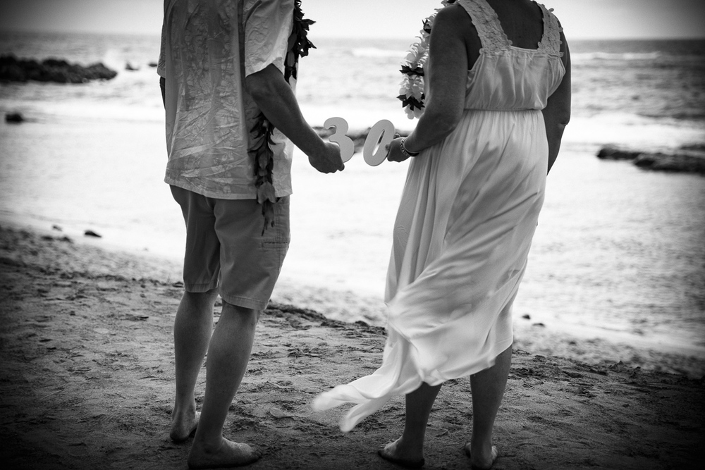 We often talk about and look at our picture book from our time in Maui and our special 30th wedding anniversary.  What a great trip we had and wonderful pictures to remember that special day! ~Theresa