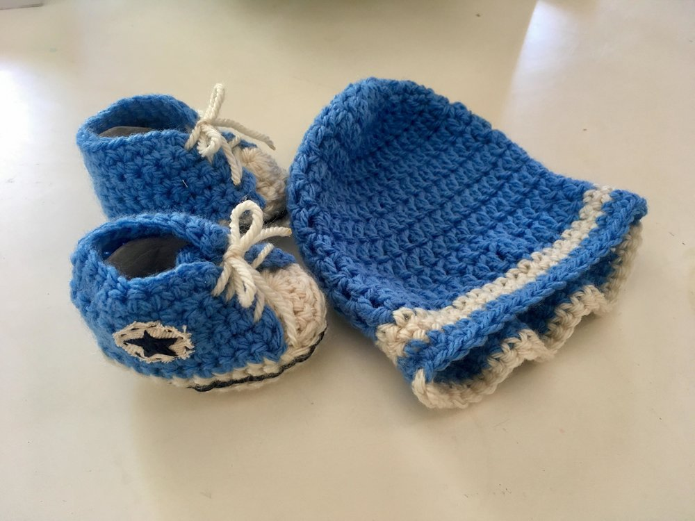 Hand knitted booties and beanie by Abuela (grandma!)