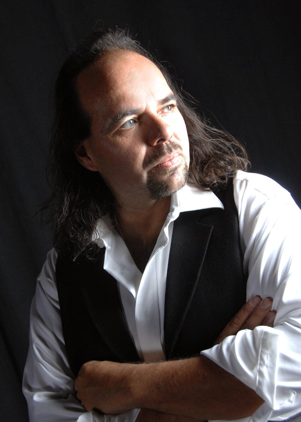 Joaquín Encinias - Associate Director