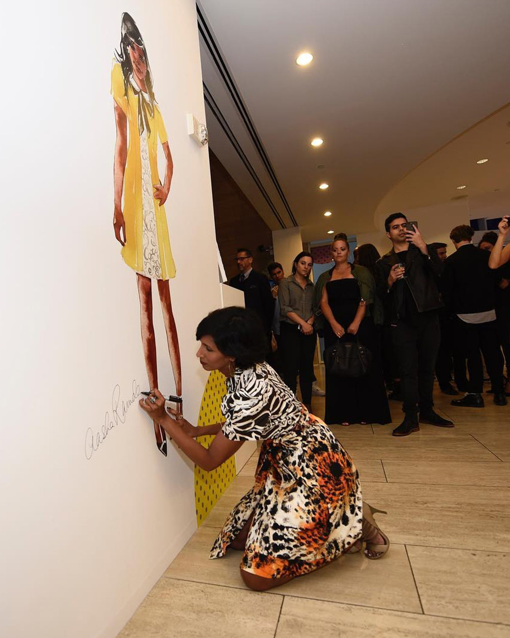 Aasha signs her art at the Beverly Hills Paley Center's Six Seasons of Style costume exhibit, celebrating The Mindy Project