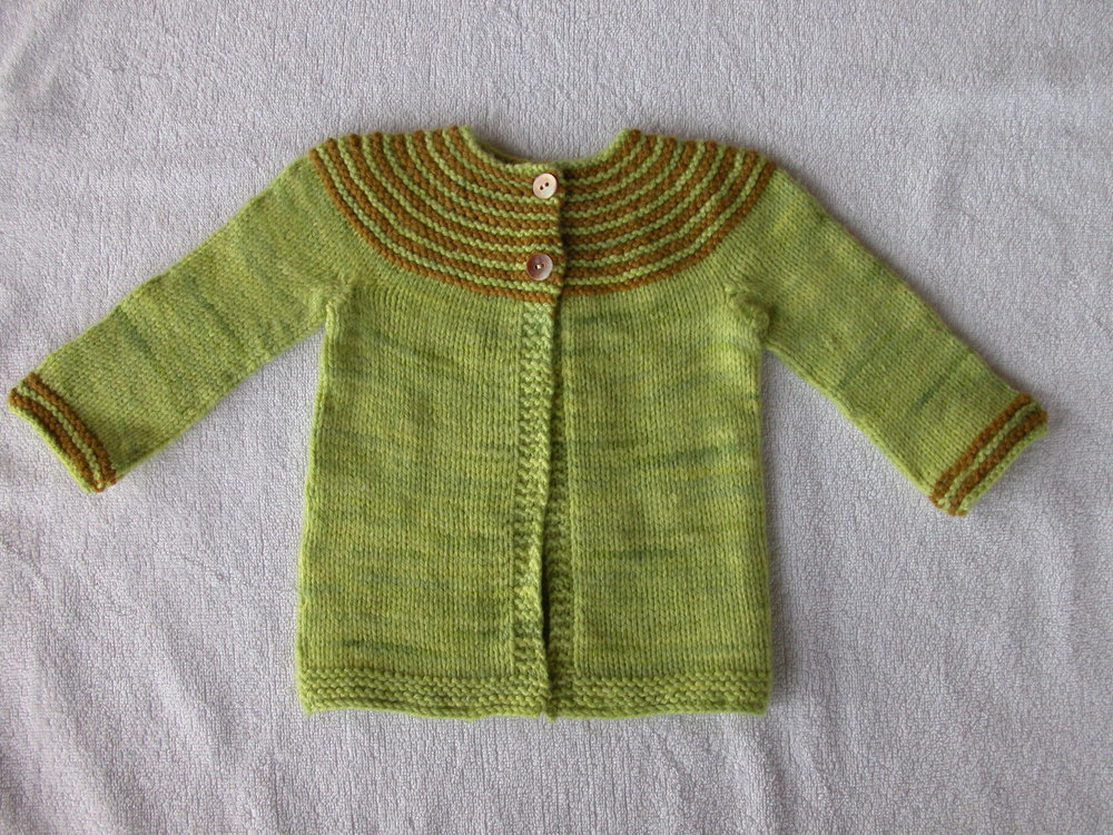 "Georgie Hallam's design ""Gidday Baby"" knitted in Augustbird's Green Tree Frog (with White Gum Wool as the base) and Sedge for baby Bo, son of friends Jules and Tom."