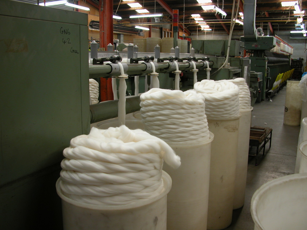 "WGW being ""gilled""–the process of aligning the fibres for a worsted spin. The sliver is pulled through the gilling machine many, many times to achieve the smooth, buttery feel of WGW yarn."