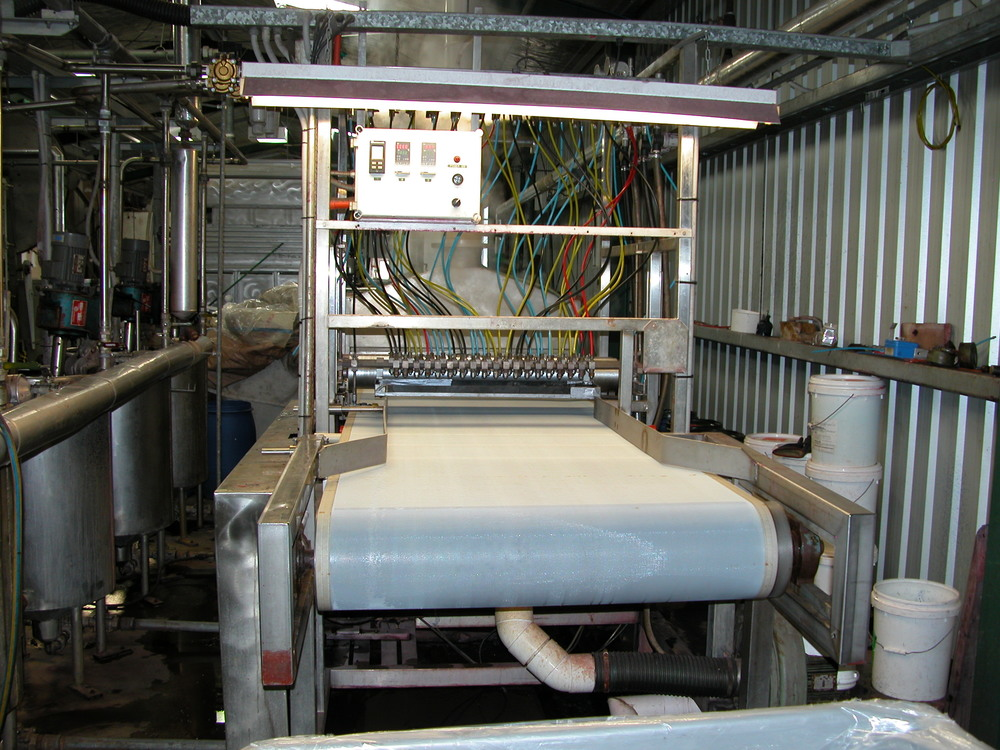…and this is Design Spun's machine for multi-dyeing. Each nozzle can squirt one of 4 different colours, a much more constrained system than hand-dyed. Peter Chatterton, one of the DS partners, started in the textile business as a lad in the dye house of major plant in the UK, and his incredible eye for colour and knowledge of what will (or won't ) work, makes it possible for him to recreate Rebecca's designs. Full points on Ashmore, Chatty!