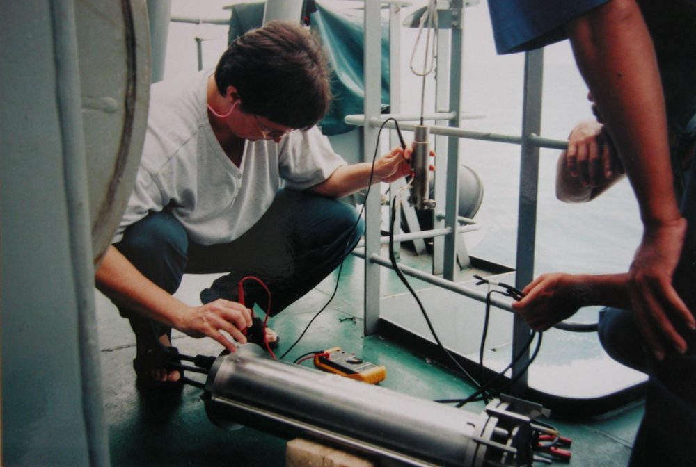 Testing the tethered instrument before preparing it to launch, aboard an Indonesian Navy research vessel near Timor (1996)