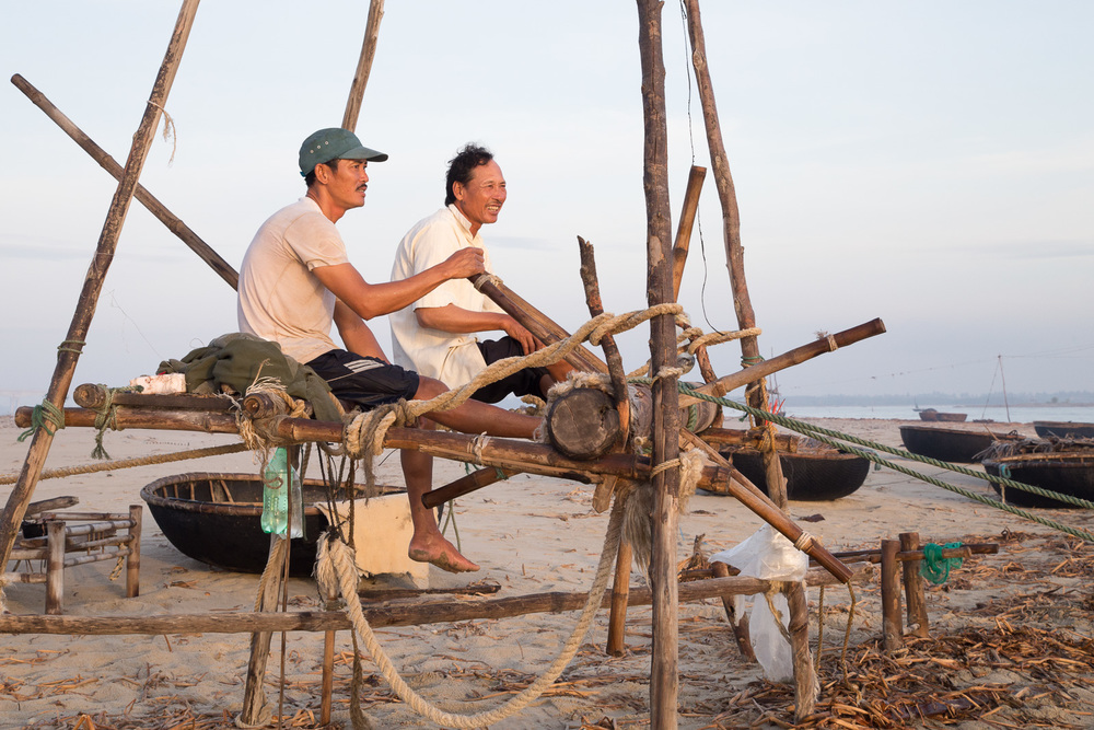 This    primitive bamboo construction is operated by the fishermen and requires great strength. A foot and hand powered winch tightens and loosens   the ropes, allowing the fishing net to lift in and out of the water.