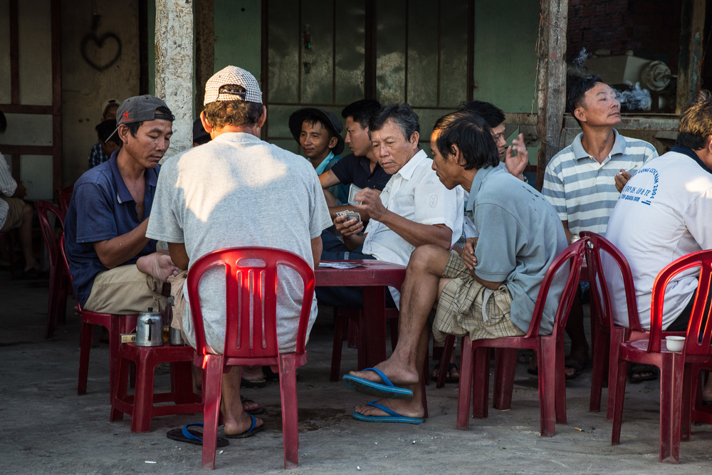 Some hard-earned down-time at 6.45am. The fishermen playing a few rounds of knock-off cards and drinking coffee at Duy Vinh Village.