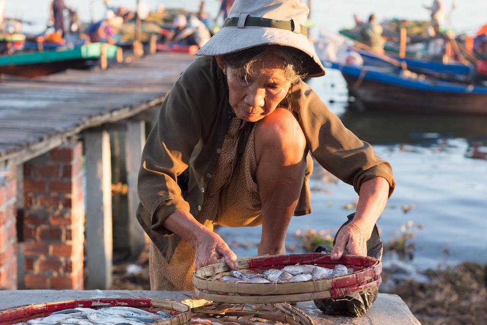Local trader arranges her wares at Duy Vinh fishing village.