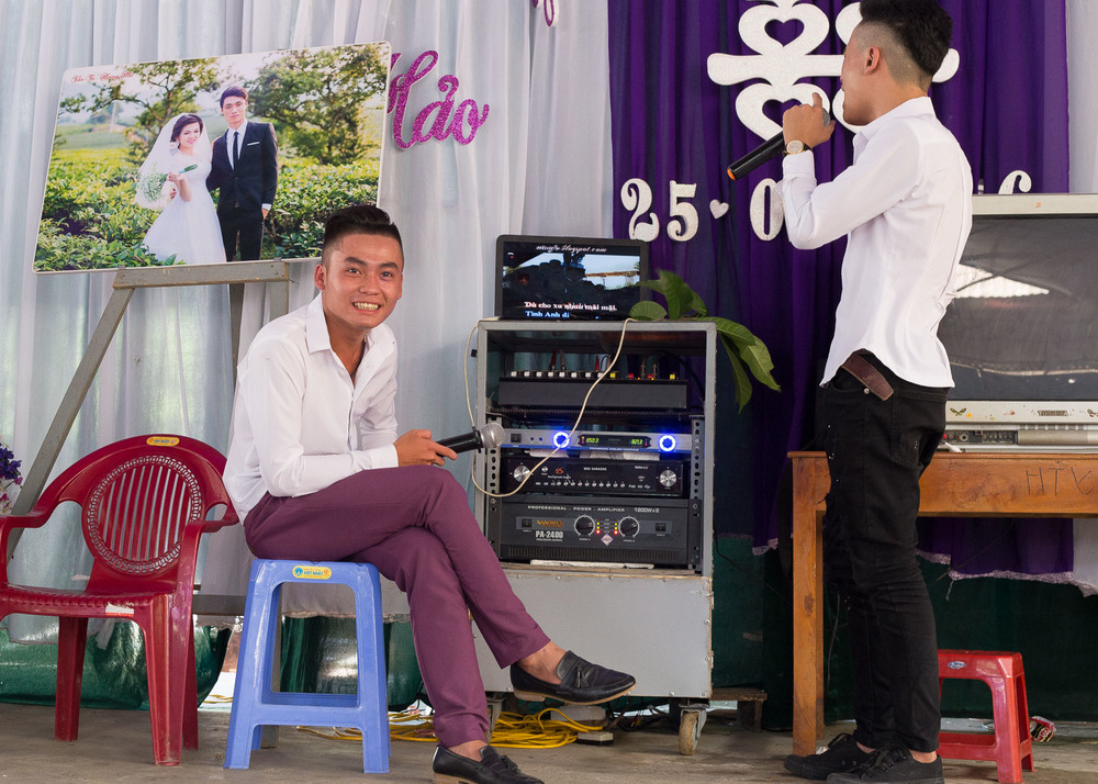 The wedding singers. While individual talents may vary when it comes to Vietnamese wedding karaoke, one thing remains universal: volume and passion.