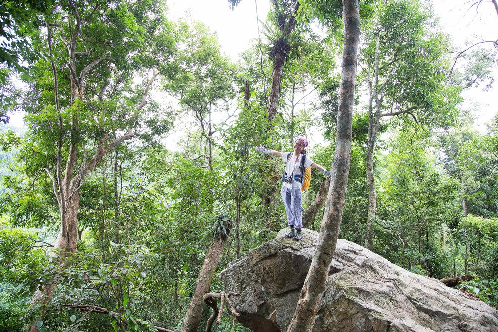 On top of the world! My new friend, intrepid Vietnamese traveller Vo Bao Tram posing in the Phong Nha-Ke Bang National Park.
