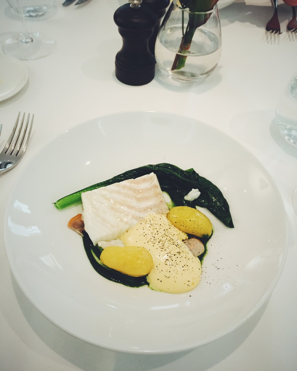 Slow-cooked Cornish Turbot with Japanese mustard leaf, smoked Linzer potatoes, seaweed sabayon and cockles