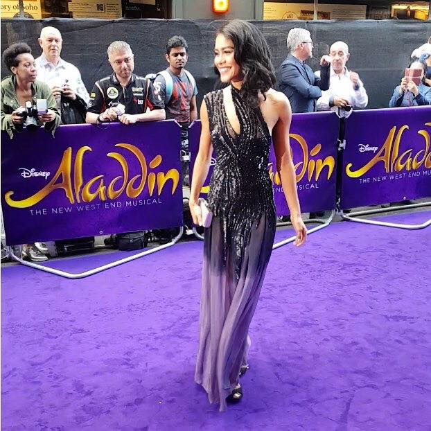 "Quote - ""Glamorous: Lucy St Louis oozed elegance in a black and purple gown that skimmed the floor as she walked""- Robin Ray Dempsey featured in the  Daily Mail"
