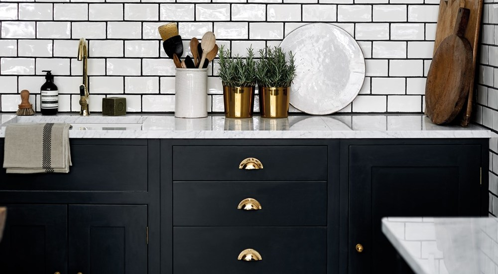 Neptune Suffolk Range – Beautiful granite worktop with sink, wall tiles and gold handles drawer unit painted in dark Farrow & Ball paint
