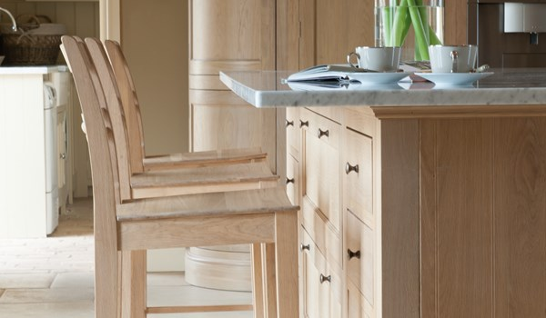 Neptune Henley Range – Stools at breakfast bar, solid oat central island unit and granite worktop
