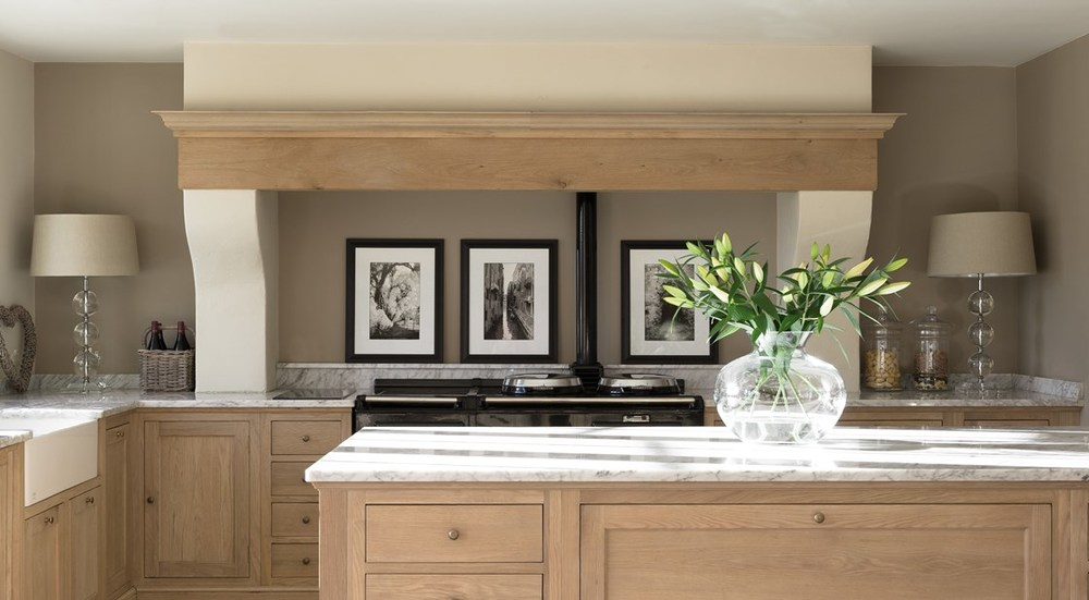 Neptune Henley Range – Side view of open plan kitchen central island unit in solid oak with Aga