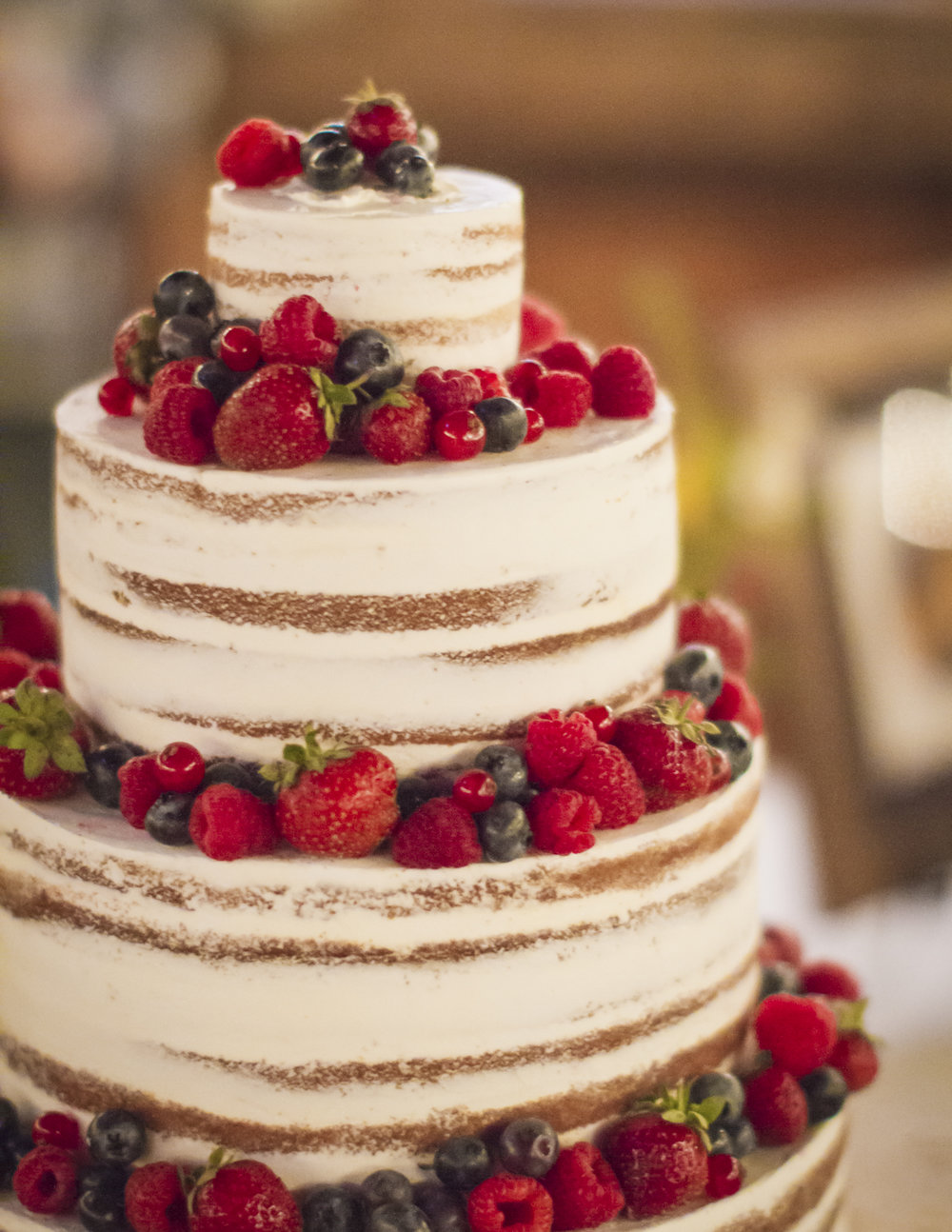 The naked cake with fresh berries.
