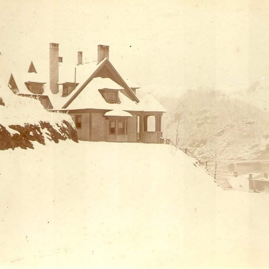Another early picture of the house covered with a blanket of snow