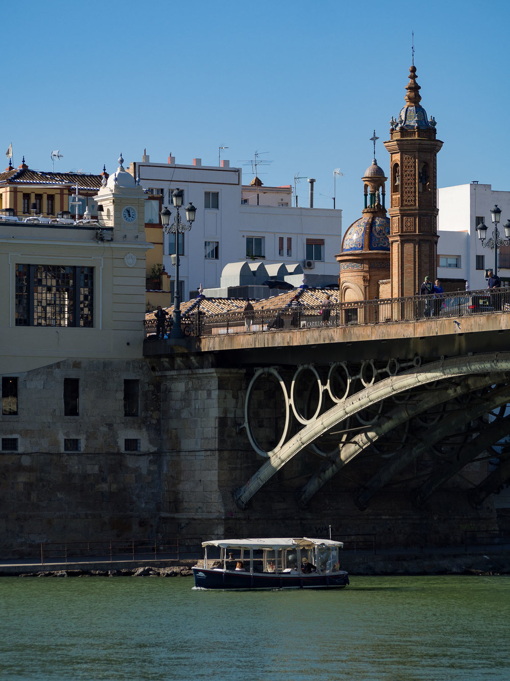 'Electric boat under Puente de Triana'  Oly E-M10 mkII + 40-150mm f/4-5.6R @ 78mm, ISO 200, 1/800, f/5.6